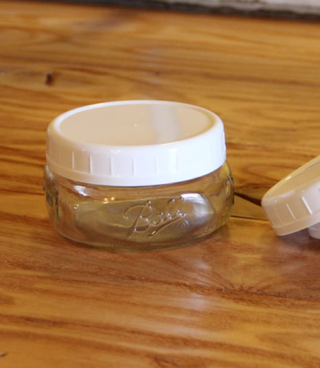 white plastic wide mouth storage cap
